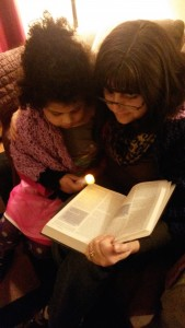 Michelle and her niece, Sage, read the Bible wrapped in God's love together at a recent Kairos Community gathering.