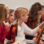 Children played a wide range of instruments at Blooming Glen congregation's Christmas Program, including violin, piano, flute, and sax. Photo by Kreg Ulery.