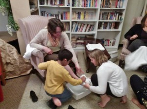 Children wash Carolyn's feet at Whitehall's Maundy Thursday worship.