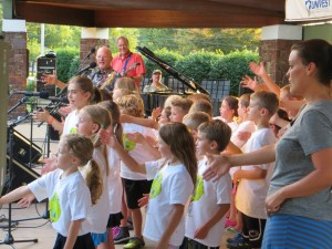 Salford's Peace Camp joins Tom Chapin on the stage during one of Souderton's Sundae  Concerts in the park.