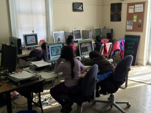 Karlton Glick, director of the New Life Internet Café, instructs computer skills classes for school-age children.