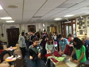 Youth assemble MCC hygiene kits.