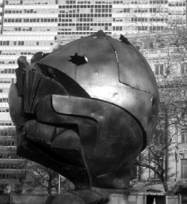 Statue of the globe managled by the destruction of the World Trade Center now located in Manhattan's Battery Park.