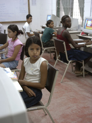 In a computer lab operated by MAMA, an MCC partner organization, 12-year-old Marta Alvarado (foreground) and other students gain the computer skills they need to thrive in an increasingly wired world. (Photo by Jenna Stoltzfus)